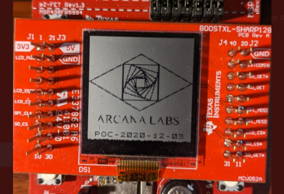 A photo of the Arcana Labs logo being displayed on PETI
